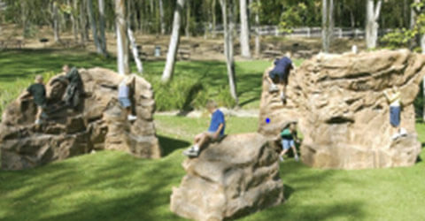 children playing on boulders
