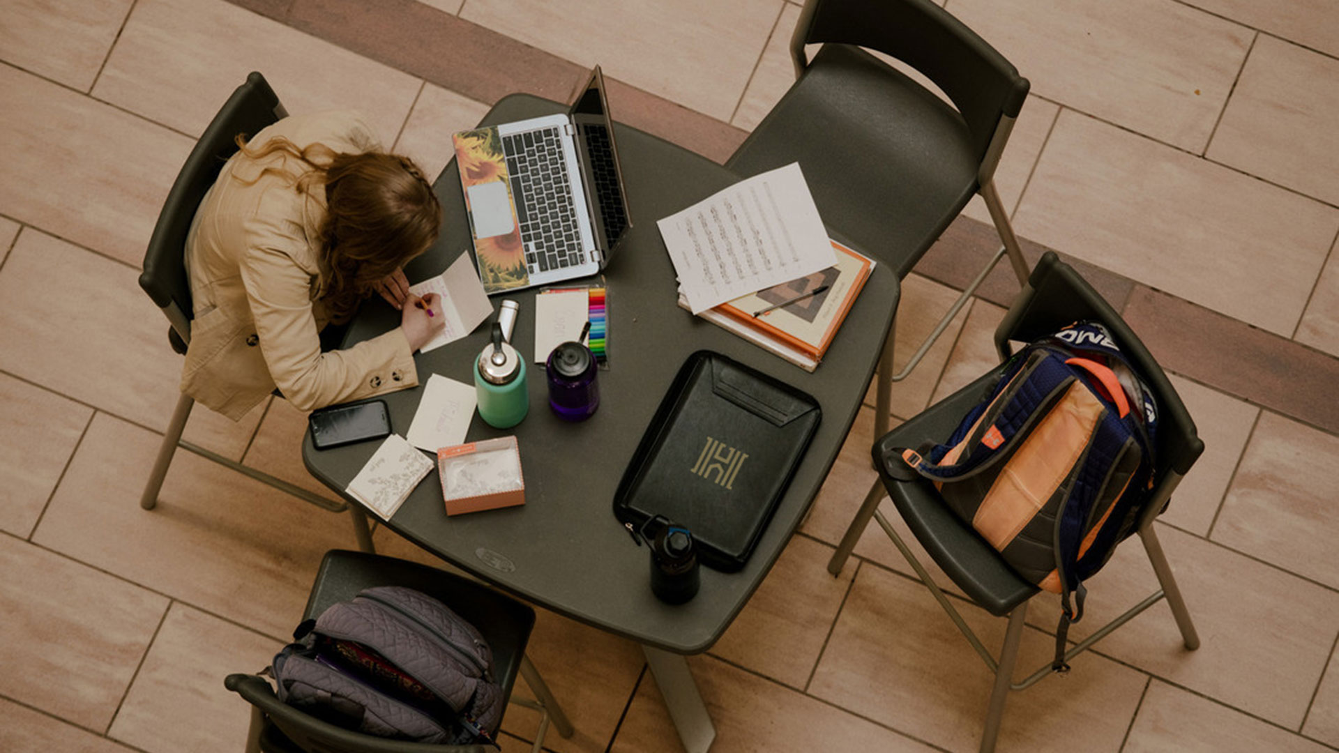 student studying online at table
